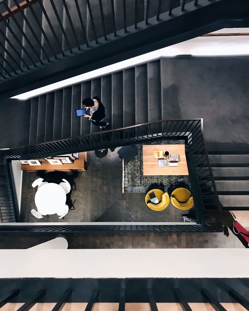 one person, real people, architecture, indoors, built structure, staircase, men, music, day, occupation, sunlight, reflection, arts culture and entertainment, lifestyles, high angle view, leisure activity, young adult, musical instrument