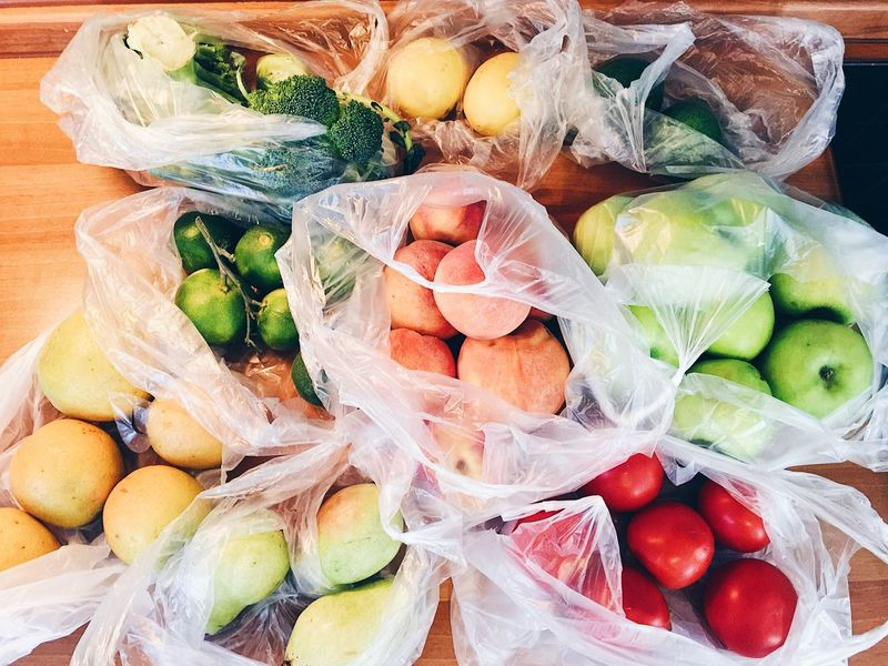 Bags with fruits and vegetables after shopping in fruit organic local market Cooking Food And Drink Market Orange Plastic Bag Shopping Vegetarian Food Apples Avocado Broccoli Colorful Eat Eco Food Food Fruit Fruits Healthy Healthy Eating Healthy Lifestyle Home Food Organic Peach Plastic Vegetable Vegeterian
