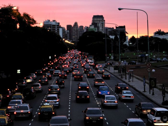 Traffic on city street at dusk
