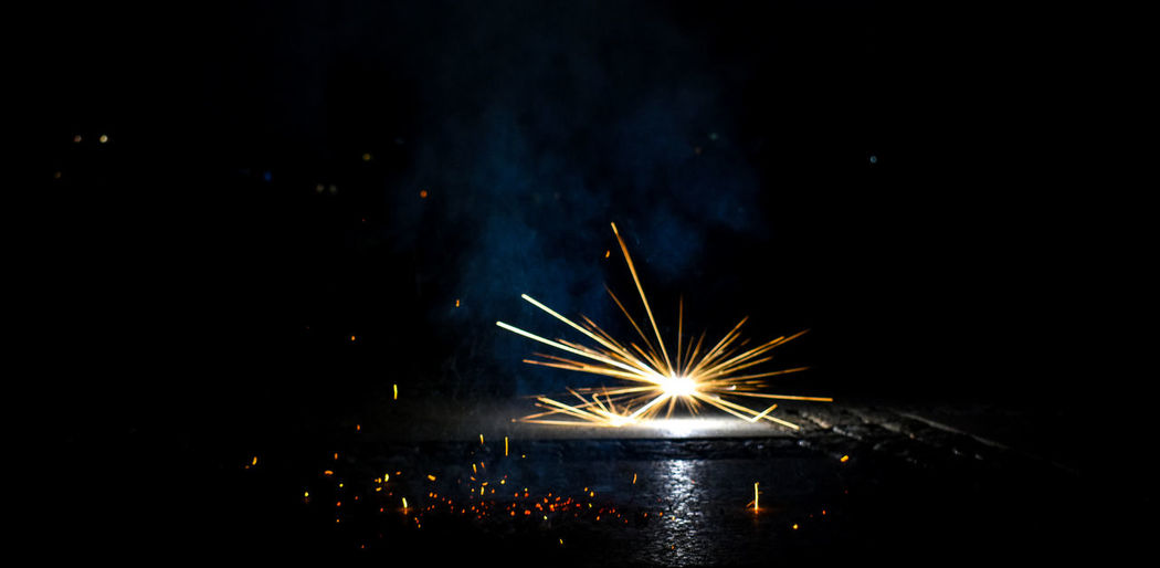 Illuminated Night Firework Celebration Long Exposure Event Firework - Man Made Object Motion Firework Display Sparks Glowing Arts Culture And Entertainment Exploding Blurred Motion Nature Burning No People Sky Light Dark Sparkler Electric Lamp