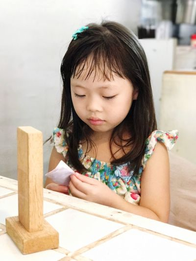 Wood - Material One Person Childhood Holding Leisure Activity Indoors  Front View Real People Girls Day Skill  Close-up Kid The Week On EyeEm EyeEmNewHere Child Children People Cute
