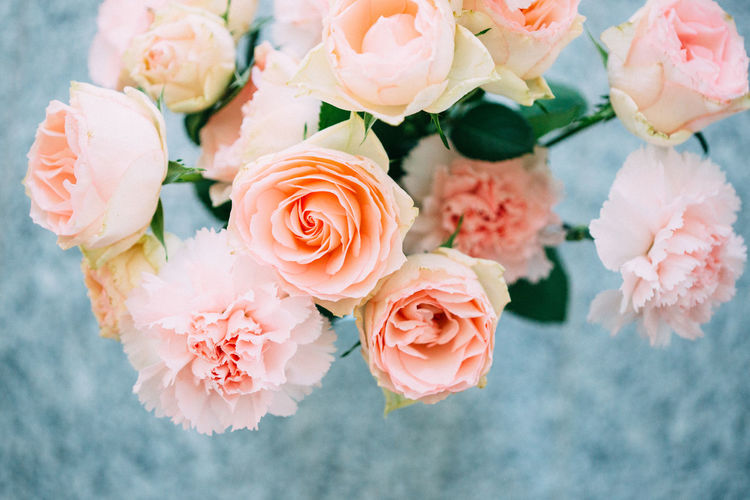 High Angle View Of Roses And Carnation Flowers In Vase