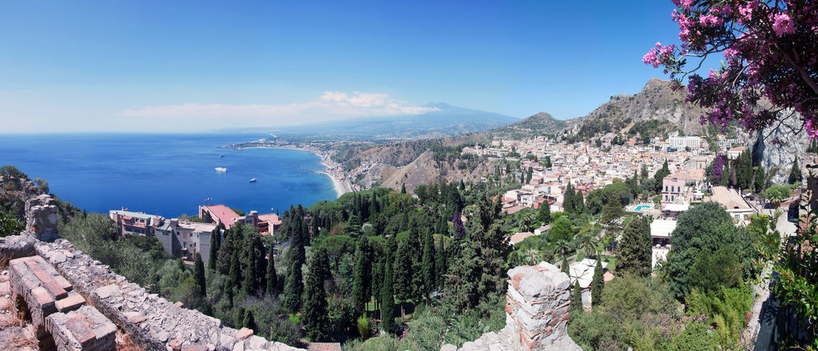 EyeEmNewHere Sea Flower Nature Outdoors Scenics Beauty In Nature No People Cliff Plant Day Travel Destinations Landscape Tranquility Beach Vacations Tree Mountain Horizon Over Water Sky Water Italy🇮🇹 Sicily Taormina And Etna Panoramic