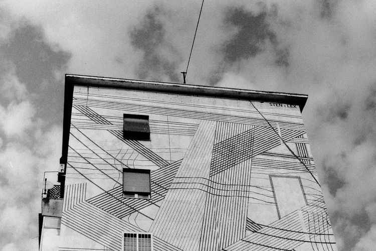 Streetart Film Photography Monochrome Clouds And Sky Lines Geometry Urban Geometry Urban Art Windows City Sky Architecture Building Exterior Built Structure Cloud - Sky