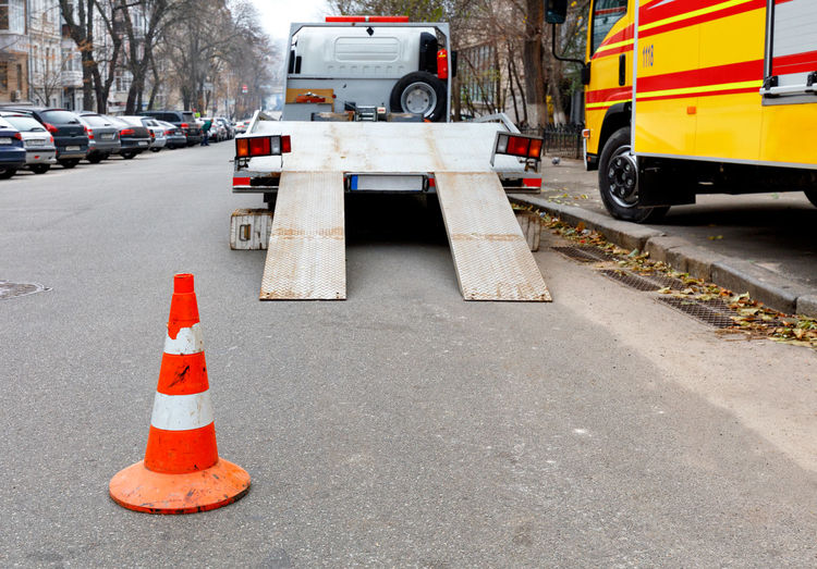 Traffic cone on road in city