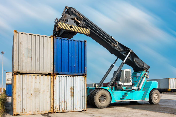 Forklift containers Forklift Logistics Shipping Containers Transport Cargo Container Cloud - Sky Commercial Dock Container Day Freight Transportation Harbor Industry No People Outdoors Shipping  Shipping Docks Sky Stack Stack Containers Train Transportation