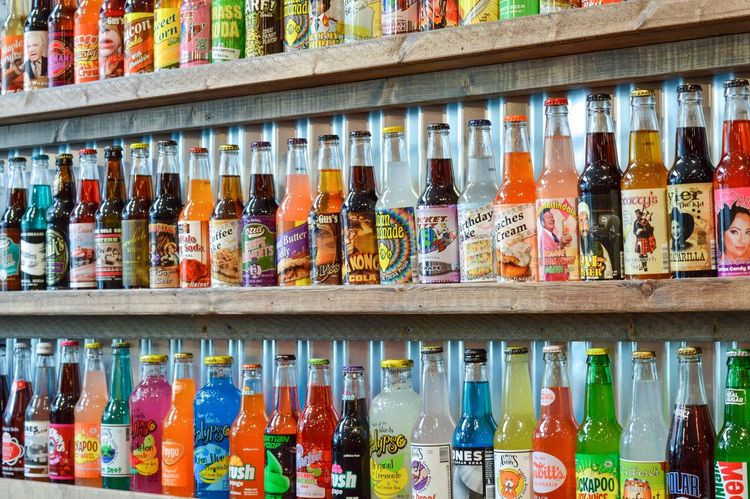 100 flavors Flavors Large Group Of Objects Multi Colored Arrangement Variation In A Row Bottle Side By Side For Sale Choice Container Abundance Shelf Retail  Drink Still Life Refreshment Food And Drink Indoors  Market No People