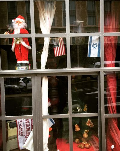 Bar window with flags on Christmas in jerusalem Israel Christmas Decoration Bar Pub Israeli Flag USA FLAG Flag Window Glass - Material Architecture Christmas No People Decoration Building Exterior Celebration Holiday Tree Transparent