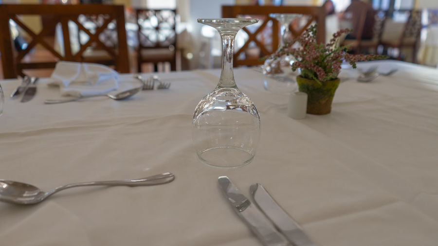 Dining Drinking Glass Eating Utensil Empty Focus On Foreground Fork Glass Glass - Material Household Equipment Indoors  Kitchen Utensil No People Place Setting Restaurant Setting Spoon Still Life Table Table Knife Tablecloth Transparent Wineglass