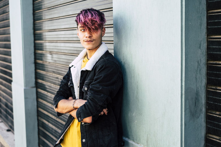 Portrait of teenage boy standing outdoors