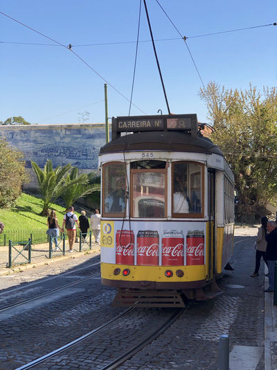 Street tram in Lisbon, Portugal Lisbon Portugal Transportation Mode Of Transportation Public Transportation Track Sky Railroad Track Rail Transportation Day Cable Car Land Vehicle Nature City Group Of People Real People Men Incidental People People Street Lifestyles Travel Outdoors