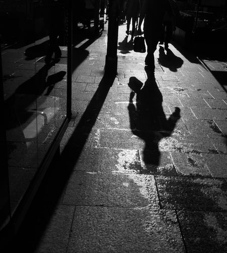 Repost For Challenge Bnw_friday_eyeemchallenge Bnw_shadows Shadow Focus On Shadow Silhouette Sunlight High Angle View Outdoors Lifestyles Streetphotography From My Point Of View Black And White Paris, France  Blackandwhite Photography Street Photography Paris ❤ People Of EyeEm People Of Paris Black And White Friday
