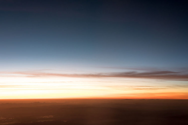 horizon in airplane Above Abstract Beauty In Nature Cloud - Sky Cloudscape Copy Space Dramatic Sky Dusk Environment Horizon Landscape Nature No People Orange Color Outdoors Scenics - Nature Sky Sunset Tranquil Scene Tranquility Twilight Urban Skyline Wildlife