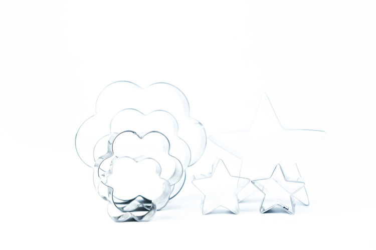 Cookie cutter shape on isolated white background. Flowers Blank Style Creative Bake Bakery Biscuit Christmas Cook  Cookie Cooking Cut Cutter Cutters Decoration Decorative Design Dessert Dough Equipment Food Frame Heart Homemade Isolated Kitchen Kitchenware Metal Metallic New Object Pastry Shape Shaped Silver  Stainless Star Texture Tools White Studio Shot White Background Copy Space Still Life Creativity Art And Craft Cut Out Pattern Group Of Objects Representation