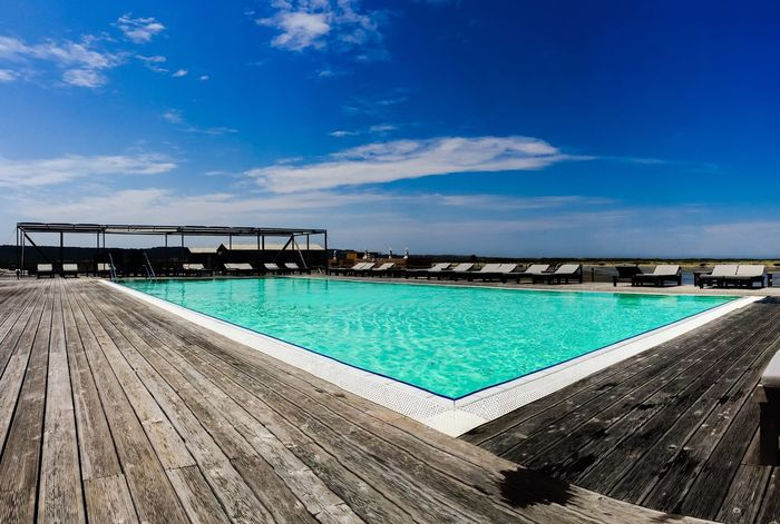 Beautiful pool in the Thalasso spa in Landscape park Piran Slovenia Great Outdoors - 2018 Eyeem Awards Great Outdoors Spa Day  Spa Time Sea Pool Piran Slovenia Seaside Sea Water Pool Sea Water Salty Water Swimming Pool Salt Pan Wooden Floor Empty Pool Turquoise Pool Turquoise Colored Water Sky Blue Cloud - Sky Swimming Pool Pool No People Sunlight Outdoors Beach Scenics - Nature Tranquil Scene Turquoise Colored The Great Outdoors - 2018 EyeEm Awards EyeEmNewHere