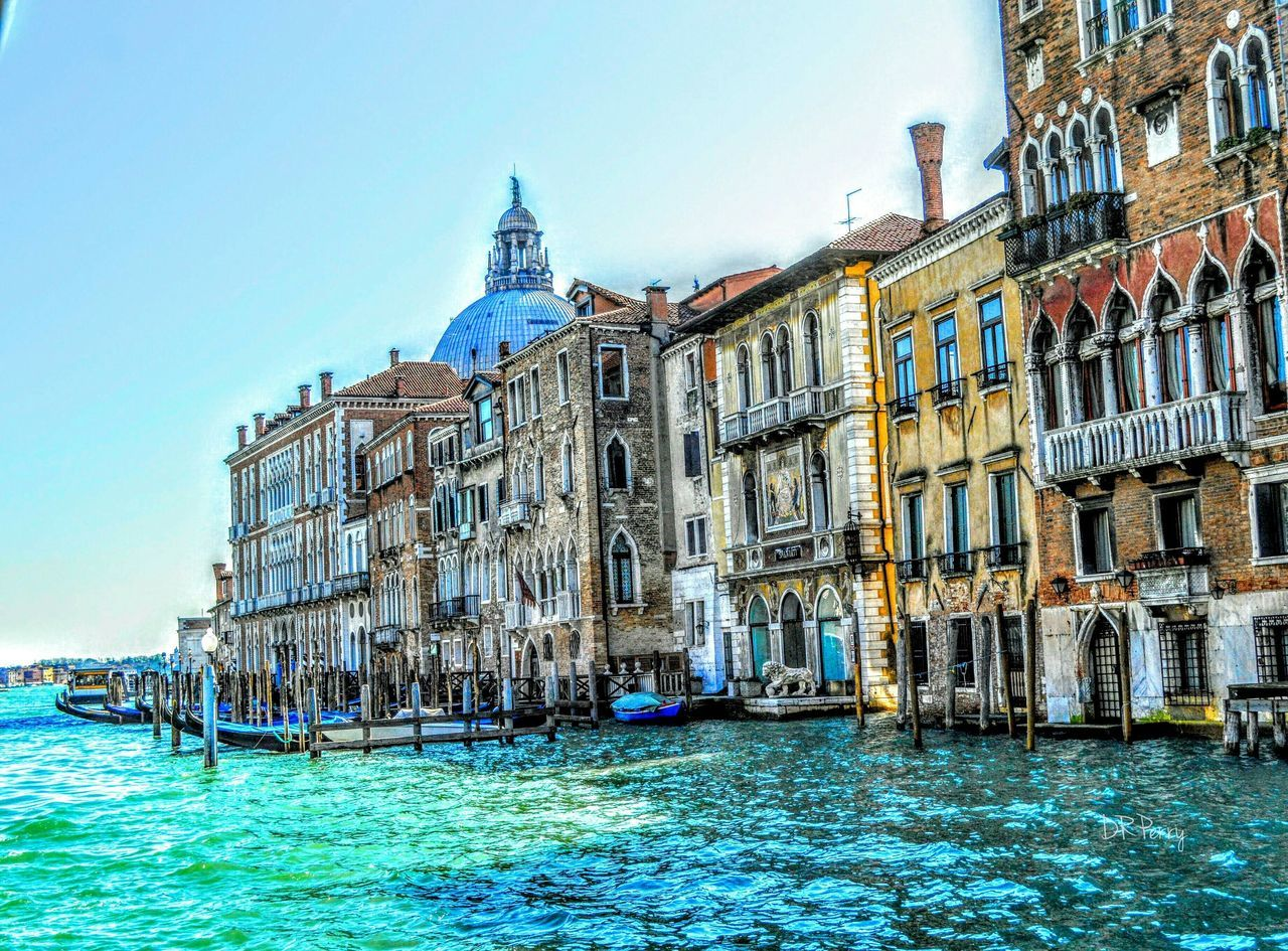 architecture, building exterior, water, travel destinations, built structure, waterfront, day, outdoors, canal, nautical vessel, wooden post, no people, sea, clear sky, nature, gondola - traditional boat, sky