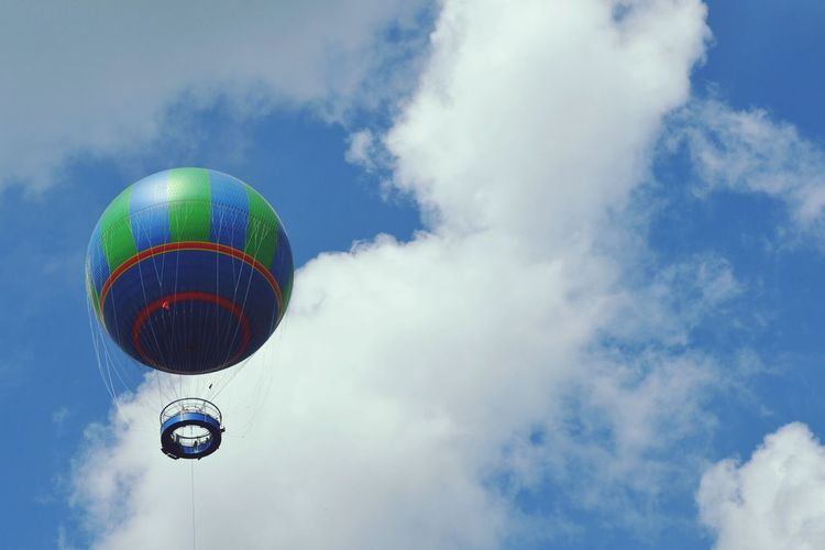 Low angle view of hot air balloon against cloudy sky