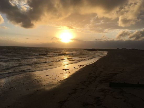 Sunset Beach Sand Sea Sky Scenics Nature Beauty In Nature Cloud - Sky Water Tranquil Scene Tranquility Horizon Over Water Sun Sunlight Silhouette Outdoors No People Wave