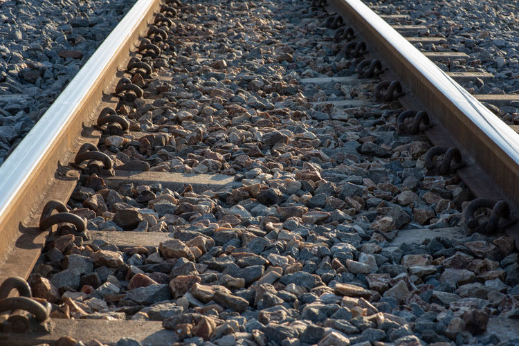 Rail Rail Transportation Track Solid Rock Railroad Track Stone - Object Rock - Object Transportation Metal Pebble Day Gravel High Angle View No People The Way Forward Abundance Stone Large Group Of Objects Direction Nature Outdoors
