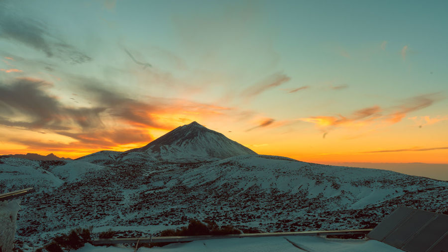 Teide National Park Teide Volcano Beauty In Nature Cloud - Sky Cold Temperature Day Landscape Mountain Mountain Range Nature No People Outdoors Paradise Scenics Sky Snow Sunset Teide Tenerife Tranquil Scene Tranquility Water Weather Winter