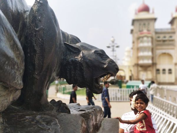 the ferocious guards of Mysore palace! Statue Monument Statues And Monuments Panther Roar Mysore Mysore Palace Mysore, India Bokeh Bokehlicious Bokeh Photography Tourism Travel Tourist People Happiness Togetherness Men Outdoors Smiling Architecture