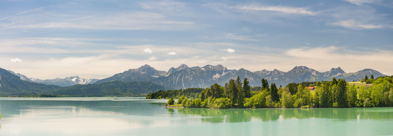 panoramic scene with alps mountains mirroring in lake Forggensee in region Allgäu, Bavaria, Germany Allgäu Bavaria Copy Space Panorama Reflection Rural Alps Beauty In Nature Forggensee Germany Lake Mirroring In Water Mountain Mountain Range Nature No People Outdoors Panoramic Landscape Reflection Scenics Tranquil Scene Tranquility Waterfall Waterfront Wide Angle