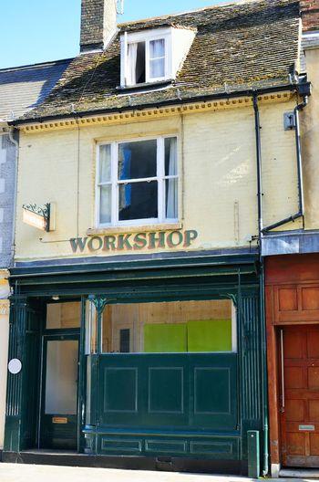 Antique workshop frontage Building Exterior Architecture Built Structure Building Façade Vintage Workshop Front View Façade Empty