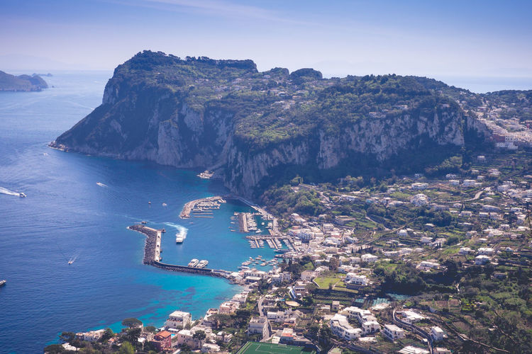 Beautiful island of Capri! Water Sea Beauty In Nature Scenics - Nature Sky High Angle View Mountain Nature Day No People Tranquil Scene Tranquility Architecture Building Exterior Land Nautical Vessel Transportation Rock Formation Idyllic Outdoors Bay Capri Italy Island Harbour Amazing View Travel Destinations Blue Water Blue Sky Cliffs Europe Greenery Beautiful Day Paradise Seaside Scenic View Landscape