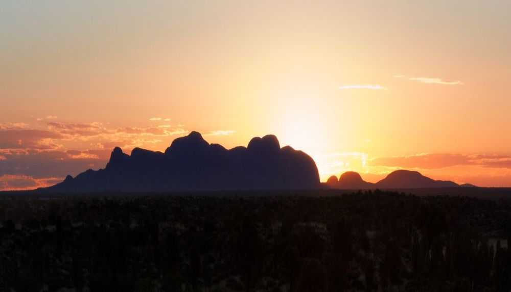 The magnificent Kata Tjuta throwing rays of light to the sky. An Australian Outback sunset from the Red Centre. Sunset Mountain Landscape Nature Scenics Silhouette Outdoors Travel Destinations No People Sky Beauty In Nature Mountain Range Beauty Dawn Australia Outback Kata Tjuta