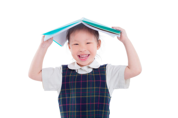School Uniform Girl Isolated White Kid Child SchoolGirl Background Young Student Education Study Beautiful Dress Pretty Learn Smart Happy Portrait Cute Little Kindergarten Studio Looking Posing Knowledge Female person One Smile Body Youth Pose STAND Enjoy Schoolkid Book Reading Asian  Chinese Holding