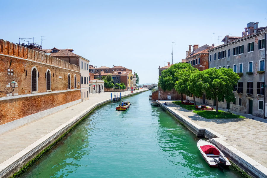 Architecture Boat Building Exterior Built Structure Canal City Clear Sky Day Gondola Large Group Of People Men Mode Of Transport Nature Nautical Vessel Outdoors People Real People Residential Building Sky Transportation Travel Destinations Tree Water Waterfront