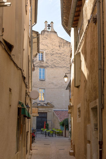 A narrow street in Orange, France Alley Architecture Between Building Building Exterior Built Structure City Life Day Long Narrow Old Town Outdoors Residential Building Residential Structure Street The Way Forward Tourism Travel Destinations Walkway Window