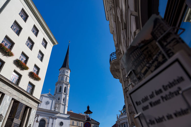 St. Michael in front of Hofburg, Vienna. Architecture Church Historical Building Low Angle View Place Of Worship Travel Travel Photography Vienna Blue Blue Sky Building Exterior Historic Lookingup Outdoors St. Michael Street Streetphotography Travel Destinations Vienna_city