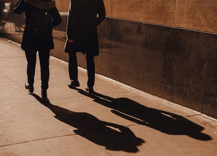 - Evening Light & Shadows Streetphotography Light And Shadow Nycphotographer eyeemphoto EyeEm Gallery Eye4photography  Travcimages Popular Photos Streetphotography Streetshot Shadow Sunlight Real People Low Section Nature City Two People Walking 17.62°