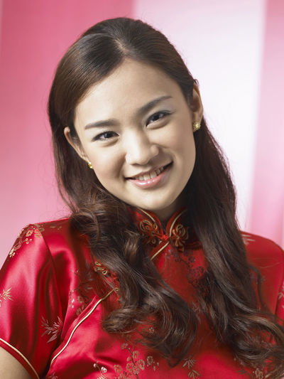 chinese woman wearing red cheongsam Red Happiness Laughing Tradition Traditional Clothing Woman Chinese Chinese New Year Close-up Cultural Festival Front View Gong Xi Fa Chai Lifestyles Long Hair Looking At Camera Oriental Style People Qipao Real People Smile Smiling Studio Shot Traditional Costume Wearing