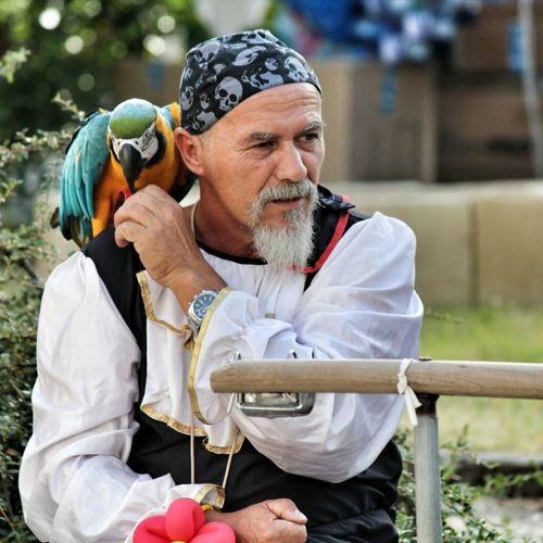 Do what you want 'cause a pirate is free, you are a pirate! Pirate Pirata Cosplay Cosplayer Man Parrot Pappagallo Colors Festival MedievalTown Fantasy Toscana Tuscany Italia Italy Vinci Borgo Fun Moments Peopleportrait People Streetphotography Collection Eyem Best Shots Eyemgallery