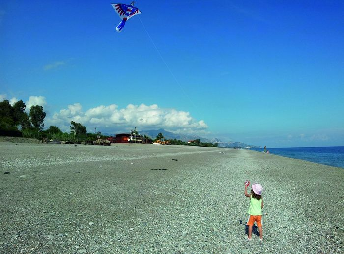 Childhood is the best time Child Girl Playing On Beach Girl Playing Freedom Life Summer Life  Nature Photography Kite In The Sky Kite On The Beach Child And Kite Water Clear Sky Sea Beach Full Length Sand Blue Standing Sky Horizon Over Water Calm #FREIHEITBERLIN