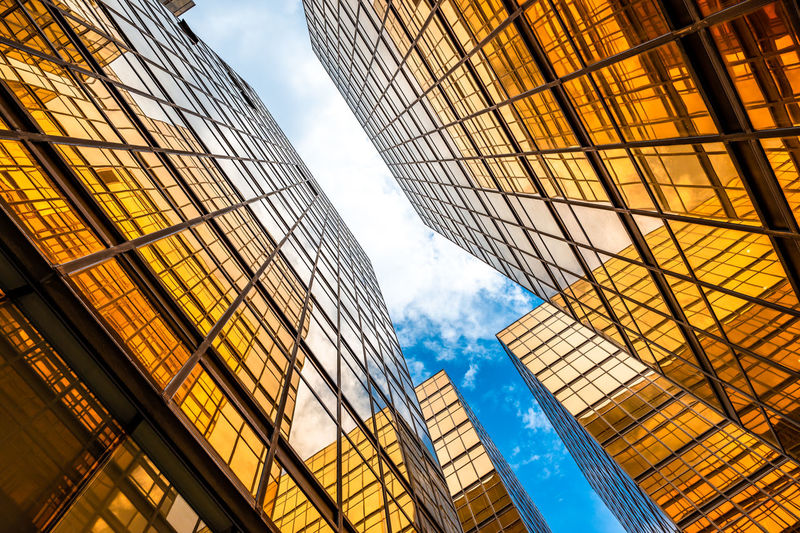 Low angle view of modern buildings in city against sky