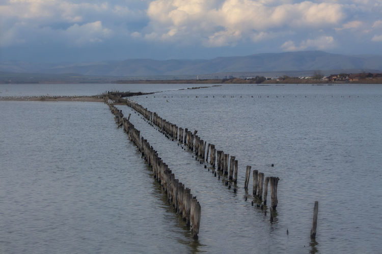 Water Scenics - Nature Tranquil Scene Tranquility Beauty In Nature Sky Cloud - Sky Waterfront Nature No People Day Post Wood - Material Wooden Post Non-urban Scene Sea Outdoors Idyllic Salt Flat Groyne