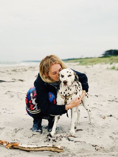 EyeEm Selects my sweet ladys at the beach. Dog Pets Dalmatian Dog Togetherness Domestic Animals Animal Themes Beach Day Sand Leisure Activity Outdoors Full Length Lifestyles Nature Bonding Mammal Sea Real People Sky Friendship