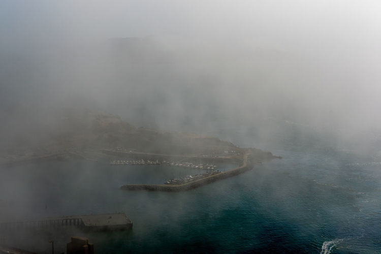 Aerial view of sea during foggy weather