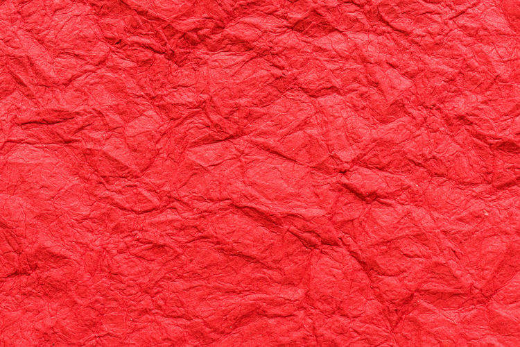 Full frame shot of red crumpled paper