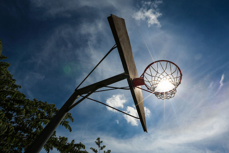 Ball Basketball - Sport Basketball Hoop Blue Cloud - Sky Day Directly Below Low Angle View Metal Nature Net - Sports Equipment No People Outdoors Plant Pole Sky Sport Sun Sunlight Tree A New Beginning My Best Photo
