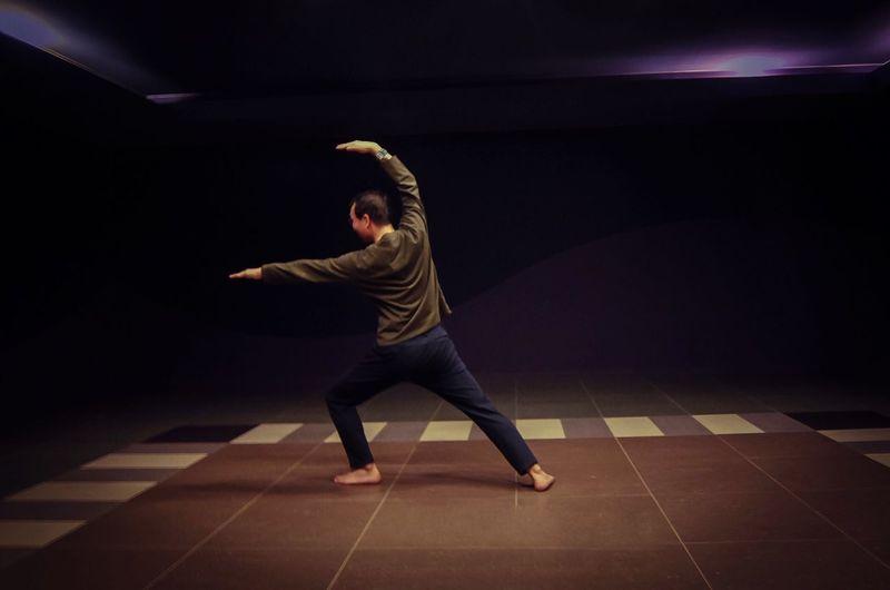 Practicing yoga Tiled Floor Illuminated Leisure Activity Dancing Black Background Yoga Yoga Pose Yoga Fitness Martial Arts This Is Masculinity
