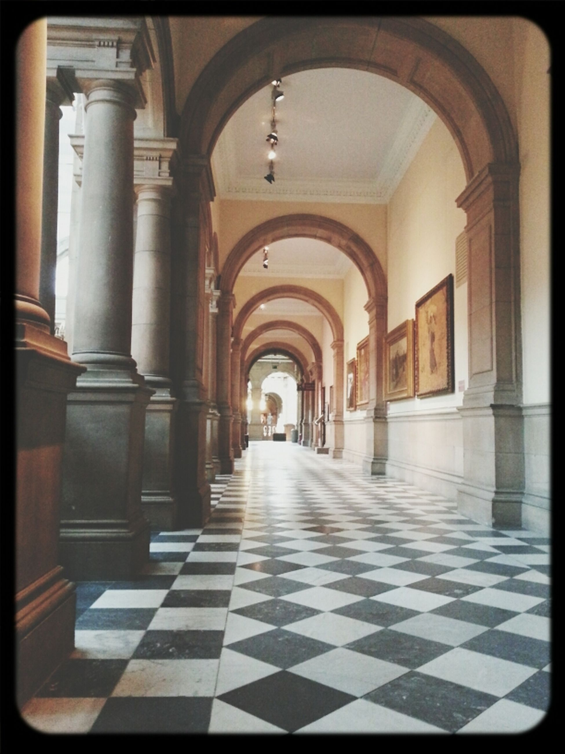 indoors, corridor, arch, architecture, the way forward, built structure, diminishing perspective, empty, flooring, tiled floor, architectural column, ceiling, in a row, column, colonnade, absence, interior, vanishing point, history, walkway