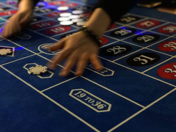 Roulette Table Number Human Hand Gambling Indoors  One Person Luck