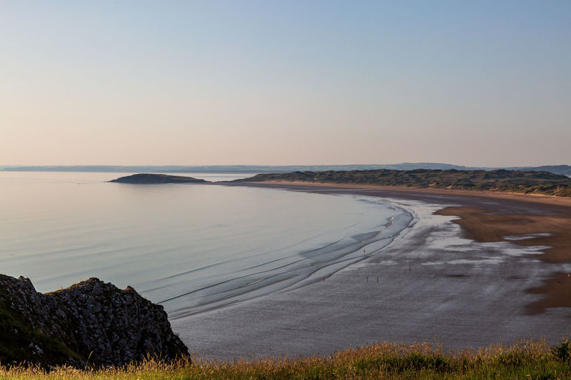 Looking out over the vast sandy beach at rhossili bay along the gower peninsula