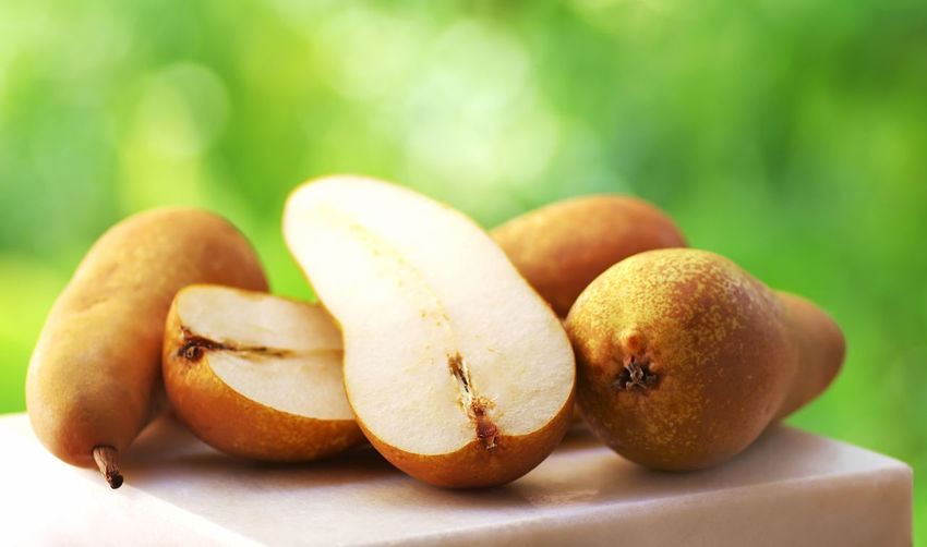 Abate Fetel pears on green background Fetel Sliced Pears Vitamin Abate Close-up Food Nature Organic