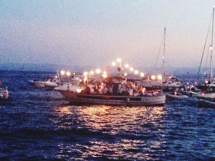 Procession On The Boat Water Nautical Vessel Transportation Sky Sea Nature Mode Of Transportation Illuminated Waterfront Motion Dusk Ship Horizon Over Water Sailboat