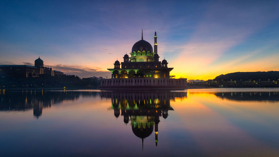 reflection of Putra Mosque Reflection Architecture Building Exterior Built Structure Water Waterfront Sunset Dome Sky Belief Religion Place Of Worship Spirituality Travel Tourism Lake Building No People Outdoors